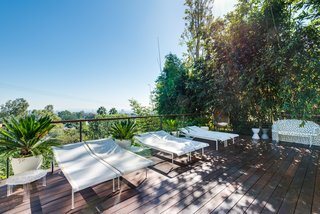 A Renovated Harry Gesner–Designed Midcentury in L.A. Wants $9.4M - Photo 11 of 15 - A shaded lounging area by the pool.