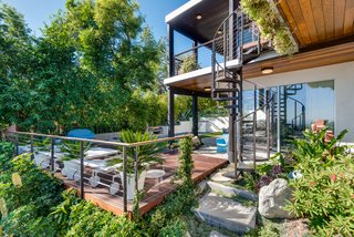 A Renovated Harry Gesner–Designed Midcentury in L.A. Wants $9.4M - Photo 9 of 15 - The patio and pool area take advantage of clement Californian weather.