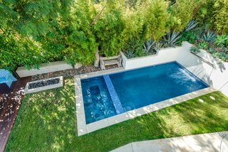 A Renovated Harry Gesner–Designed Midcentury in L.A. Wants $9.4M - Photo 10 of 15 - A view of the pool from the terrace.