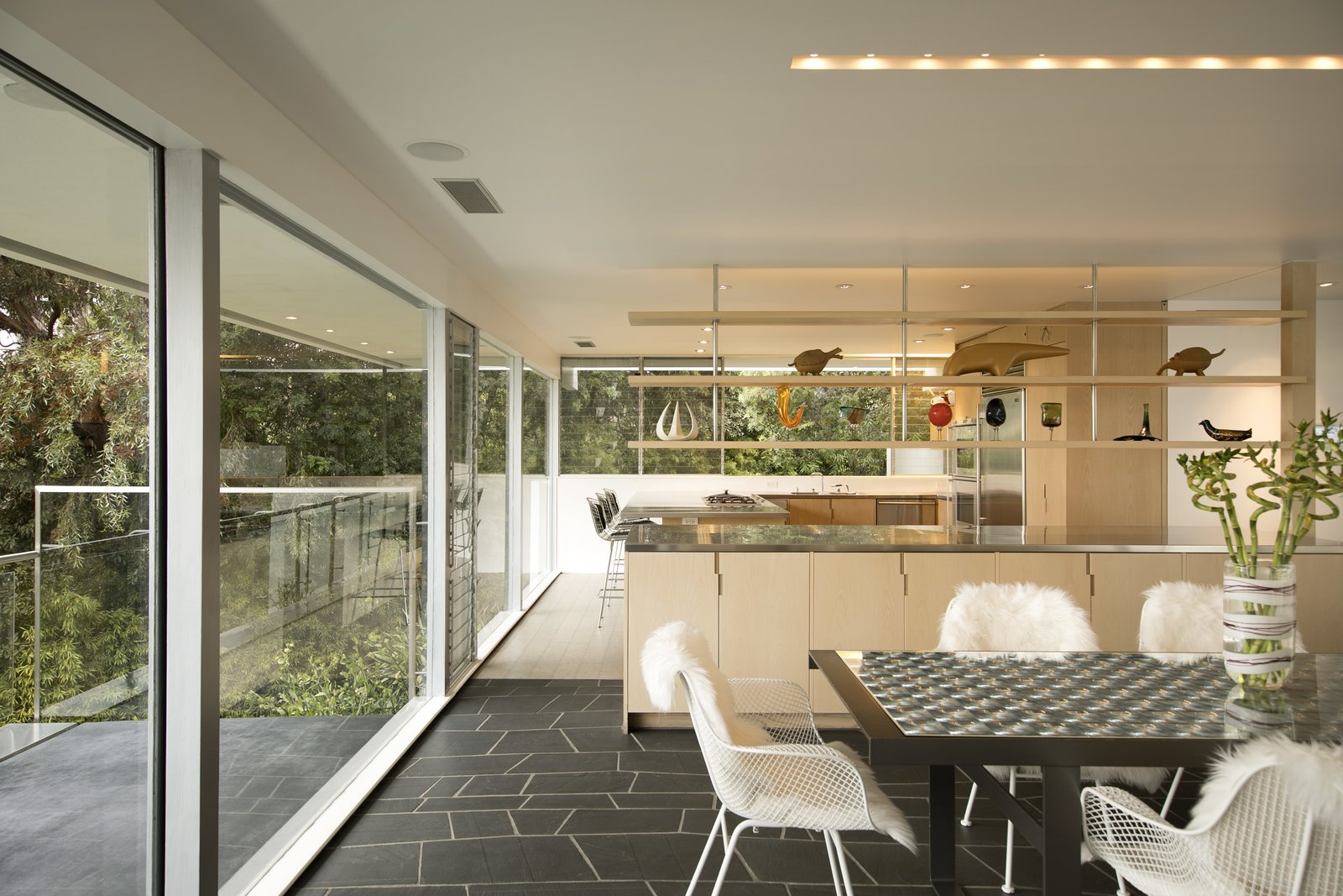 ash cabinetry and stainless steel appliances in the kitchen and living room  tagged  kitchen photo 4 of 13 in a restored midcentury jewel by richard neutra      rh   dwell com