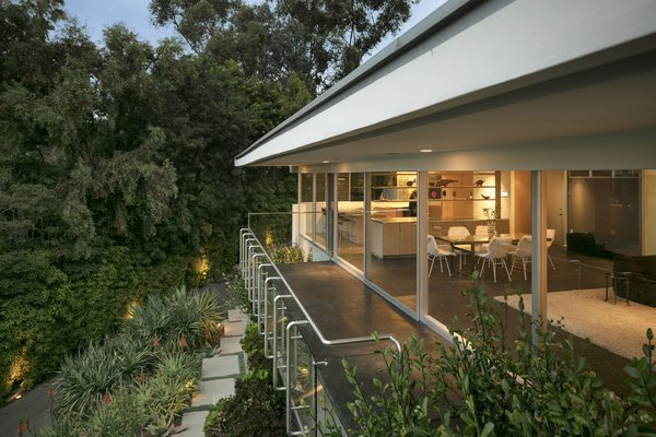 Originally designed as a single story residence the home features clean lines and an indoor-outdoor connection.