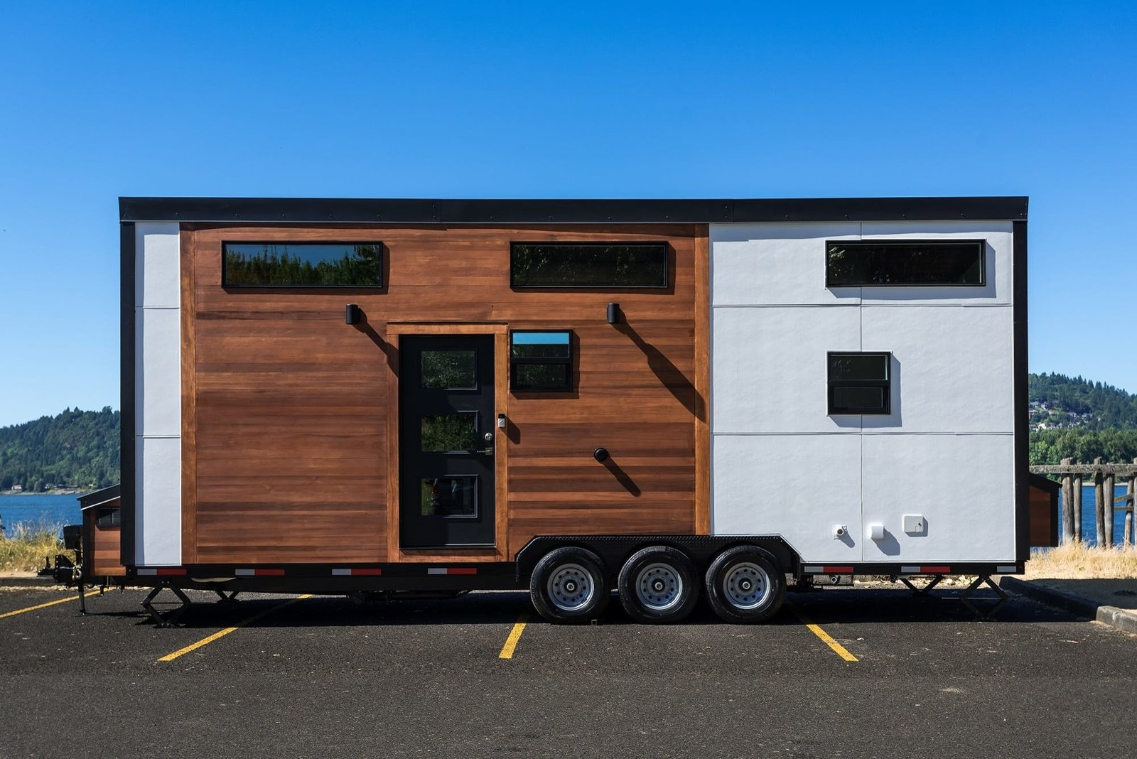 The Oregon-based tiny home builder's flagship model, the Catalina, has a bright airy feel and offers which has a sleek look cool modern interiors.The home comes in three sizes—24, 28, or 32 feet—and features exterior details such as cedar accent siding and black metal framing. The home has two lofts, one for storage and one for sleeping, ample living space, a bathroom with a full shower, bathtub and toilet, and an optional solar setup allows the home to run off the grid. The Catalina starts at $65,000.  Photo 3 of 13 in 12 Tiny House Companies That Can Make Your Micro-Living Dreams Come True