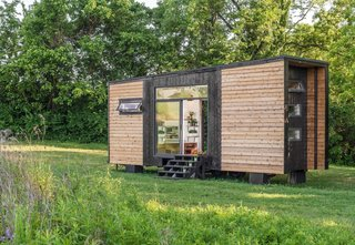 12 Tiny House Companies That Can Make Your Micro-Living Dreams Come True - Photo 7 of 12 - The Alpha from New Frontier Tiny Homes is one of the fanciest tiny homes around. The 240-square-foot modern design is super functional and good looking to boot. The company also has a larger model known as Escher, that is around 300 square feet and has two bedrooms. The Alpha model starts at $124,000 and the Escher starts at $139,000.