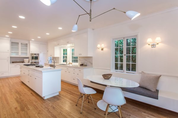 The bright modern kitchen is state of the art and includes a small open breakfast nook.