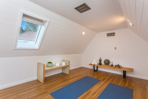 An upstairs yoga practice space.