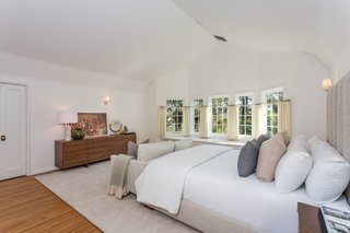 Moby Lists His Newly Renovated Los Feliz Manor For $4.5M - Photo 15 of 19 - This bright bedroom has an ensuite bath and a wood-burning fireplace.