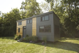 12 Tiny House Companies That Can Make Your Micro-Living Dreams Come True - Photo 8 of 12 - For the last two years, Brian Crabb has been designing and building custom tiny homes from the ground up all over the world. The Modern is a 238-square-foot smart home that features loft-style sleeping accommodations, as well as a full bathroom and kitchen.