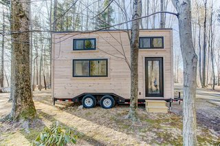 12 Tiny House Companies That Can Make Your Micro-Living Dreams Come True - Photo 9 of 12 - The Mohican from Modern Tiny Living is made by Amish craftsmen in Ohio and can be built in as little as eight weeks. This 20-foot tiny home has an unfinished contemporary exterior, as well as a bright minimalist interior that packs all the essentials into a compact footprint. It retails for about $59,000.
