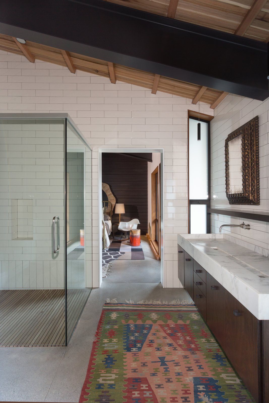 An ensuite bathroom is shared by two of the bedrooms.