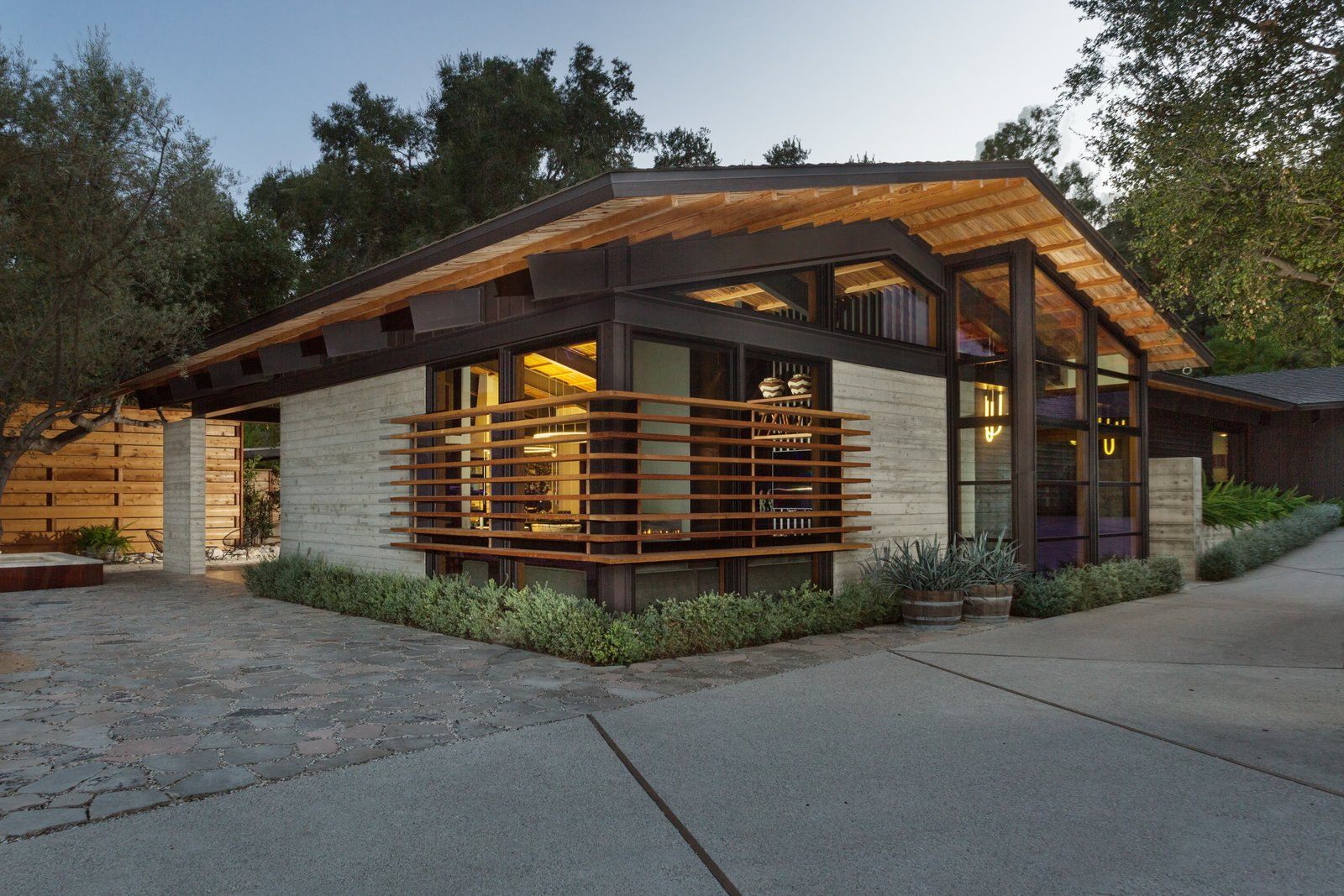 The main house channels a midcentury vibe.