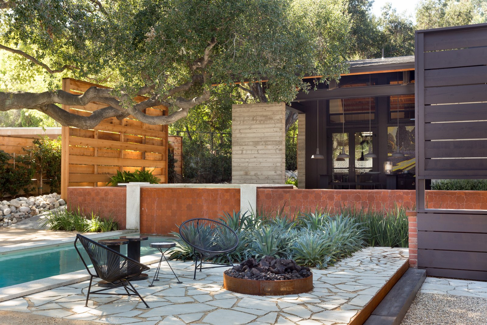 The outdoor space includes a fire pit.