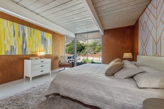 An Elegant Eichler Hits the Market at $1.15M in Northern California - Photo 14 of 21 - The master bedroom overlooks the backyard.