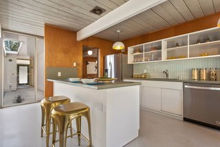 An Elegant Eichler Hits the Market at $1.15M in Northern California - Photo 7 of 21 - The updated kitchen is now home to a cozy breakfast bar.