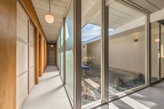 An Elegant Eichler Hits the Market at $1.15M in Northern California - Photo 17 of 21 - A hallway overlooking the atrium.