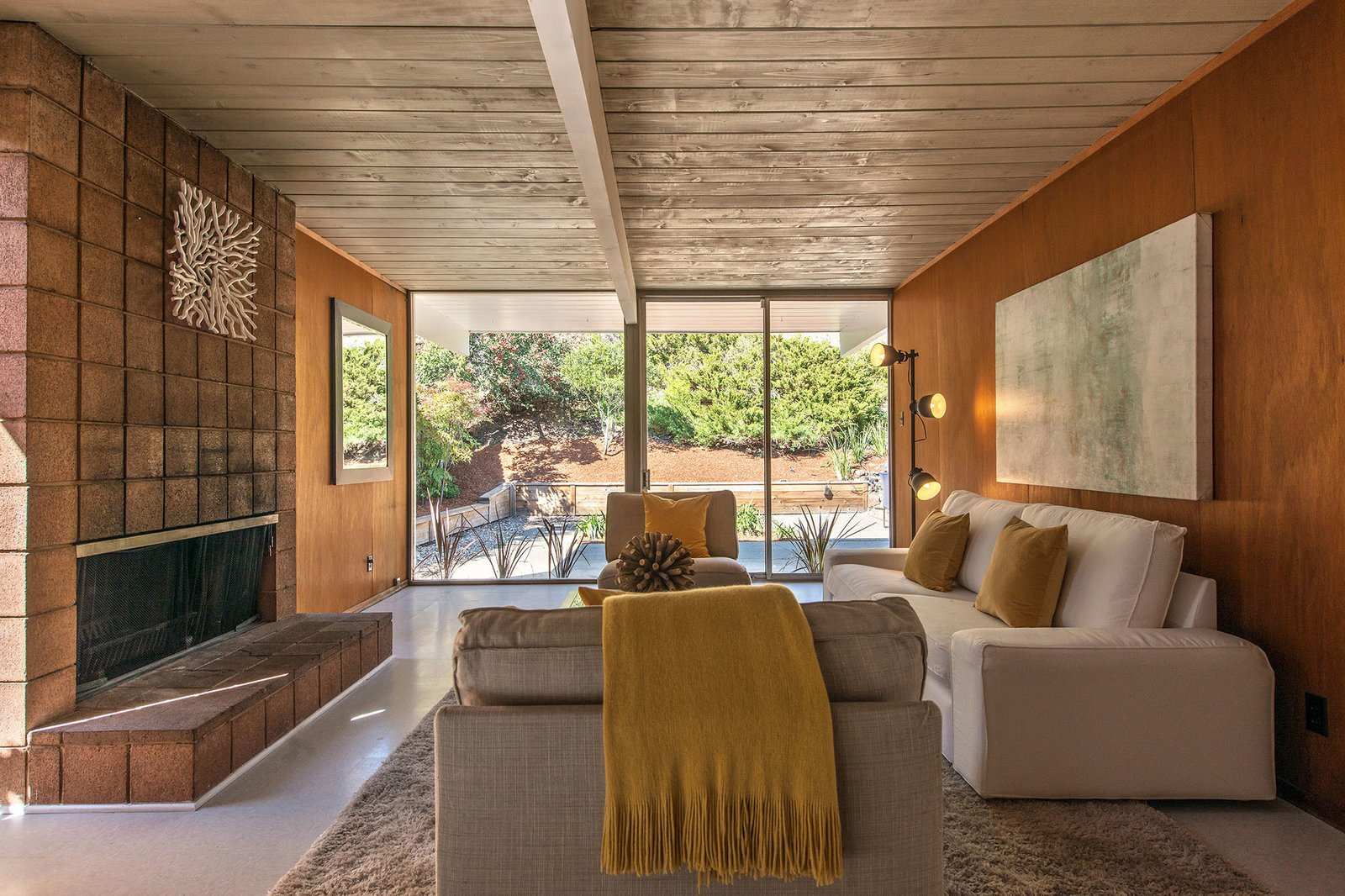 A more formal open living room features a fireplace.