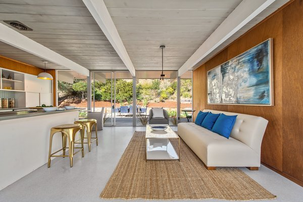 The ceilings have been painted white creating a more expansive sense of space.