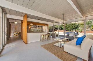 An Elegant Eichler Hits the Market at $1.15M in Northern California - Photo 3 of 21 - The interior of the home unfolds into an open kitchen/living area, creating multiple social spaces for entertaining.