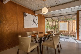 An Elegant Eichler Hits the Market at $1.15M in Northern California - Photo 12 of 21 - The dining area overlooks an outdoor patio.