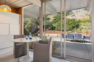 An Elegant Eichler Hits the Market at $1.15M in Northern California - Photo 9 of 21 - A small eating area overlooks the lush backyard.