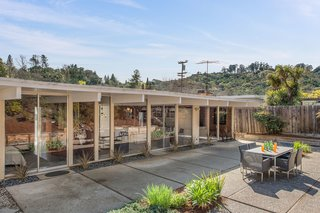 An Elegant Eichler Hits the Market at $1.15M in Northern California - Photo 20 of 21 - A wall of windows lines the rear of the home, allowing for even more natural light.