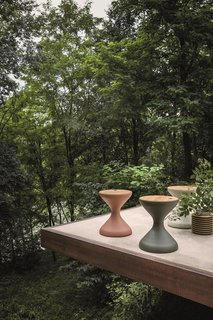 This Teak Outdoor Living Collection Pairs Sustainability and Scandinavian-Inspired Style - Photo 7 of 11 - The Bells round side table with an ice bucket insert, also designed by Pedersen, is an elegant, sculptural form with an emphasis on function.