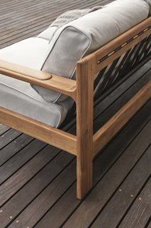 This Teak Outdoor Living Collection Pairs Sustainability and Scandinavian-Inspired Style - Photo 5 of 11 - Comfortable cushions are supported by teak frames and partially elasticated outdoor webbing straps. Thoughtful design details, like subtle curves, add a level of sophistication that the company is known for.