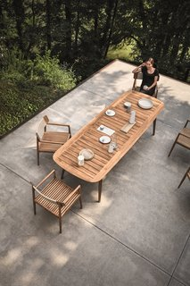 This Teak Outdoor Living Collection Pairs Sustainability and Scandinavian-Inspired Style - Photo 8 of 11 - Inspired by teak decking, and echoing the craftsmanship and design of the Tea Clippers that opened trade routes around the world, Pedersen clearly references his inspiration, using generous deck-like slats, finely tapered legs that hint at a ship's mast—even giving the table a hull-like edge. The Clipper collection is simultaneously a nod to a nautical past, as well as a new take on al fresco dining.