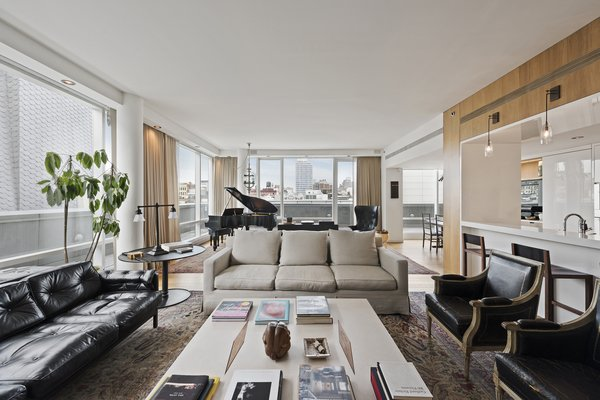 The floor-to-ceiling windows give dramatic proportions and a sweeping view of the city.