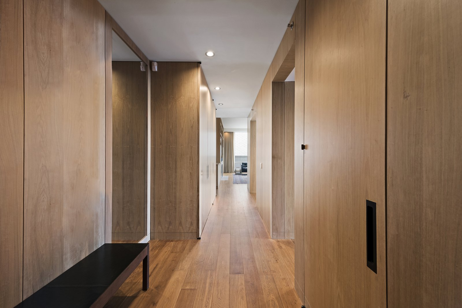 Wood-lined walls hold storage space and match the six-inch-wide plank oak flooring.