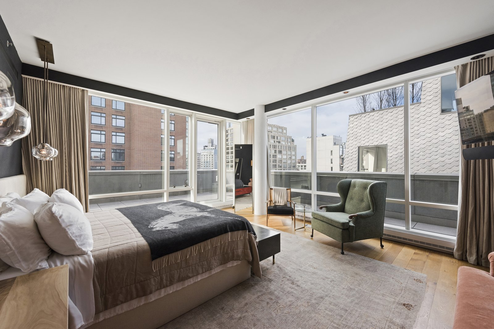 The master bedroom features floor-to-ceiling windows and terrace access as well as a deluxe ensuite bathroom.