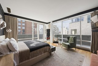 Own Justin Timberlake's Posh Soho Penthouse For $8M - Photo 5 of 8 - The master bedroom features floor-to-ceiling windows and has terrace access, as well as a deluxe ensuite bathroom.