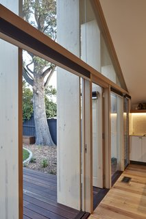 A Contemporary Extension Gives This Australian Home a New Face - Photo 4 of 11 - The wood was simply stained and left in its natural state, which reduced the need for more costly structural steel.