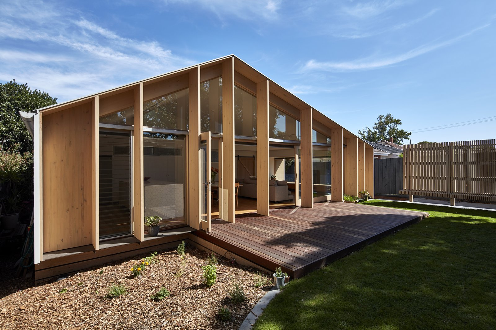 The pitched roof reduces the extension's surface area to 12 percent less than that of a flat-roofed extension, creating a more compact building envelope—which translates to less material needed for construction and less space to heat or cool.