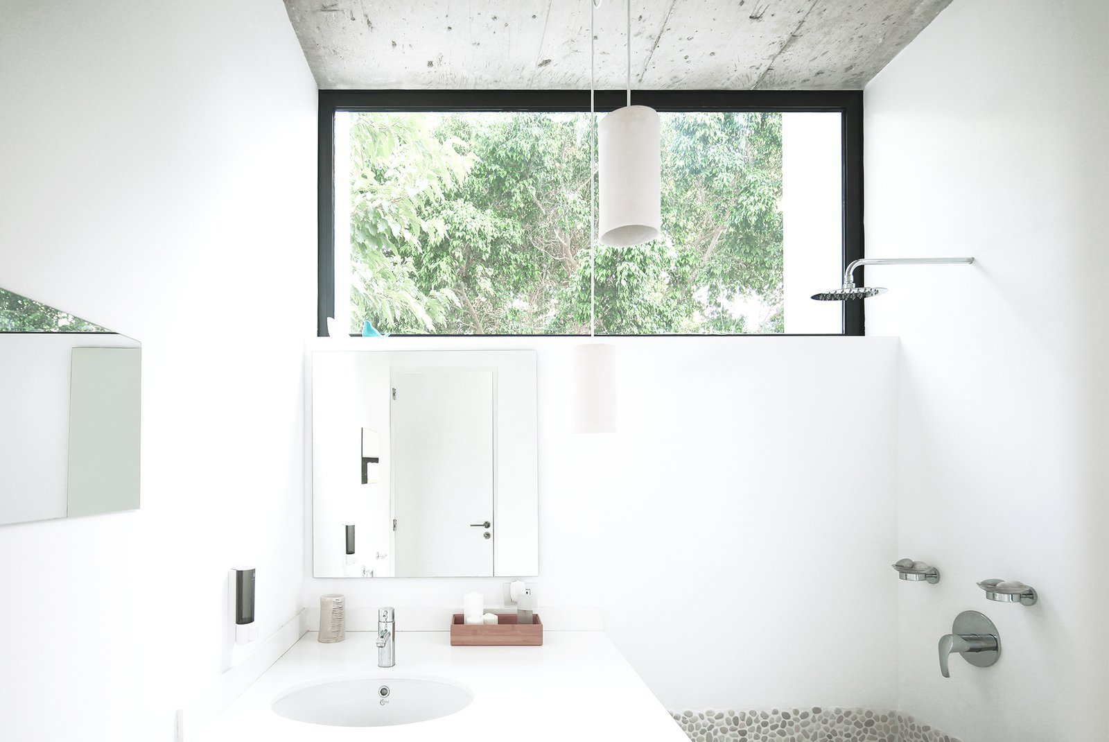 The bathroom maintains a sense of outdoor living with the large clerestory window.