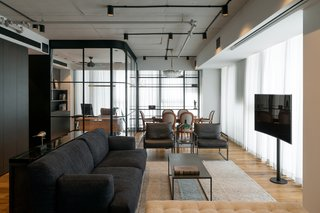A Home Office is Cleverly Integrated Into the Living Room of This Compact Condo
