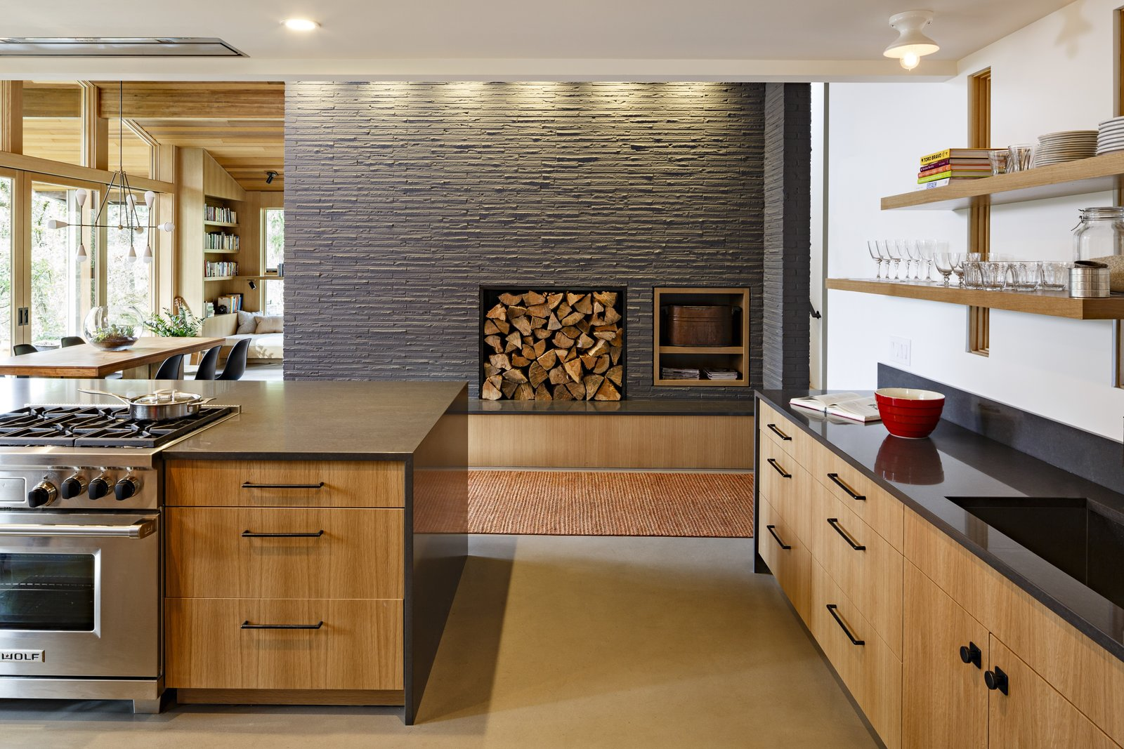 The fireplace core, which is open on both sides to the living room and here in the kitchen, had been covered in sheetrock. The design team exposed the original brick adding character and period-appropriate authenticity to the rooms.