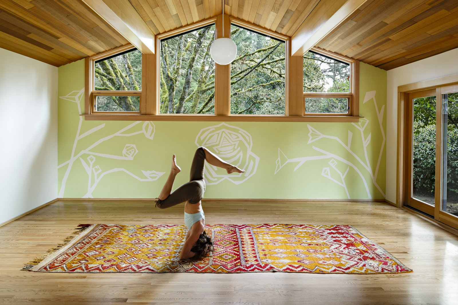 The original garage had been previously converted into a home office space. However, with the addition of wood ceilings, and sliding doors leading out to the garden it was transformed into a yoga studio for the homeowner where she now teaches and practices daily.