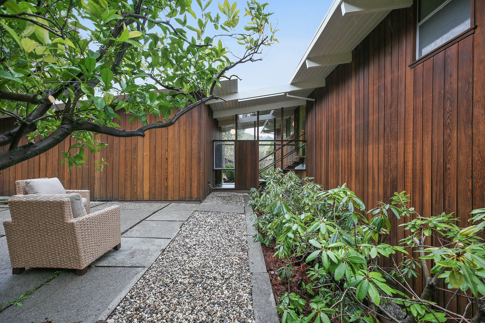 The home has a strong connection to the outdoors, despite missing the central a