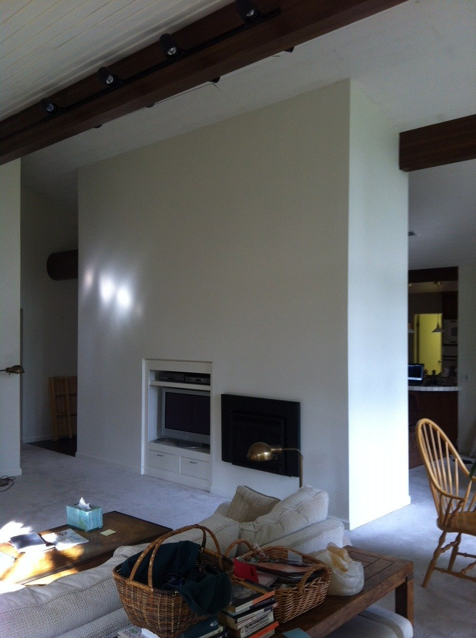 The fireplace covered in drywall.