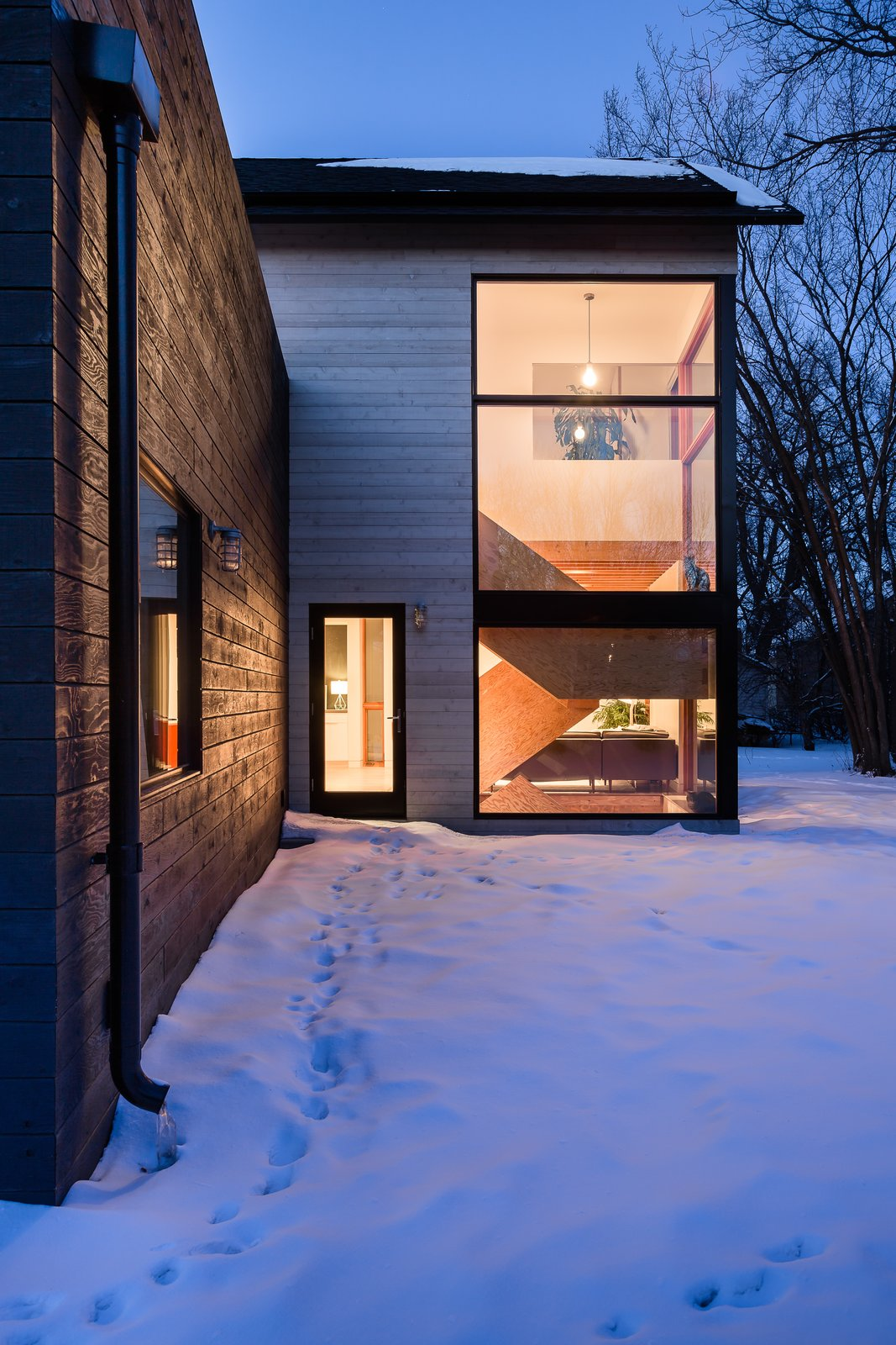 To help keep costs at bay, the dark exterior siding and feature staircase were constructed of fir plywood.