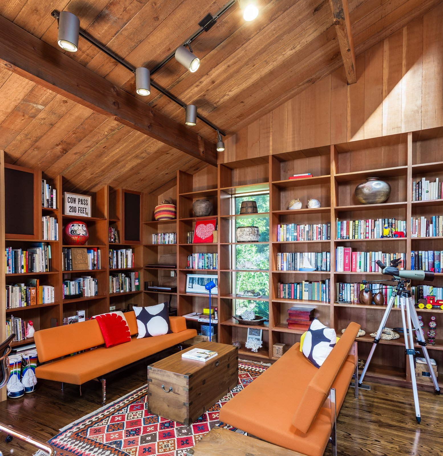 A den filled with built-in bookshelves.