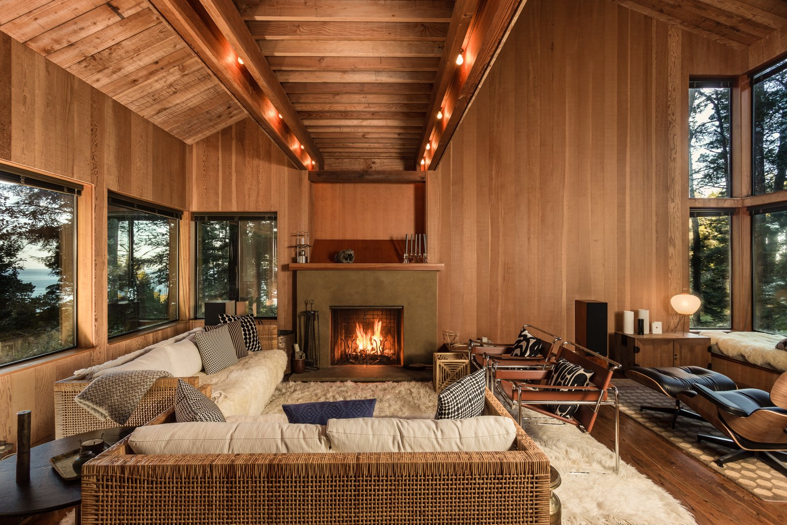 Douglas fir interiors and ample glazing convey a oneness with nature throughout the living area.  <span style=
