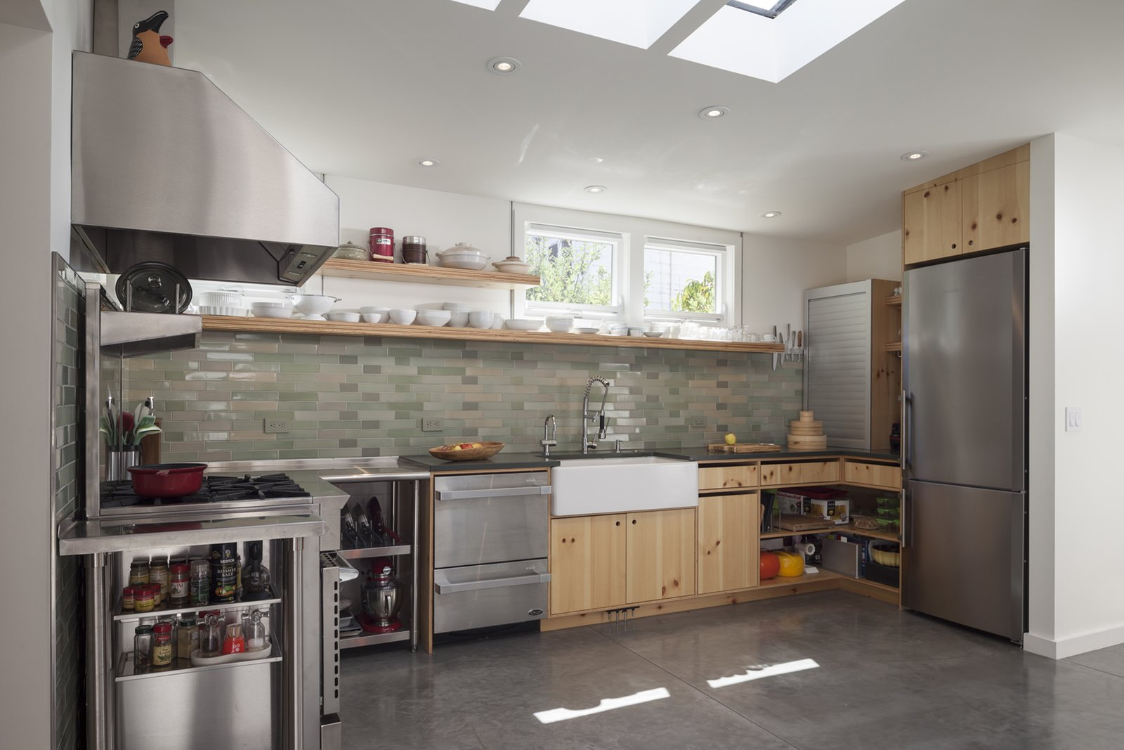 Tagged: Kitchen, Granite Counter, Metal Counter, Wood Cabinet, Concrete Floor, Glass Tile Backsplashe, Recessed Lighting, Range, Drop In Sink, Refrigerator, and Range Hood.  Shotwell Residence by Todd Davis Architecture