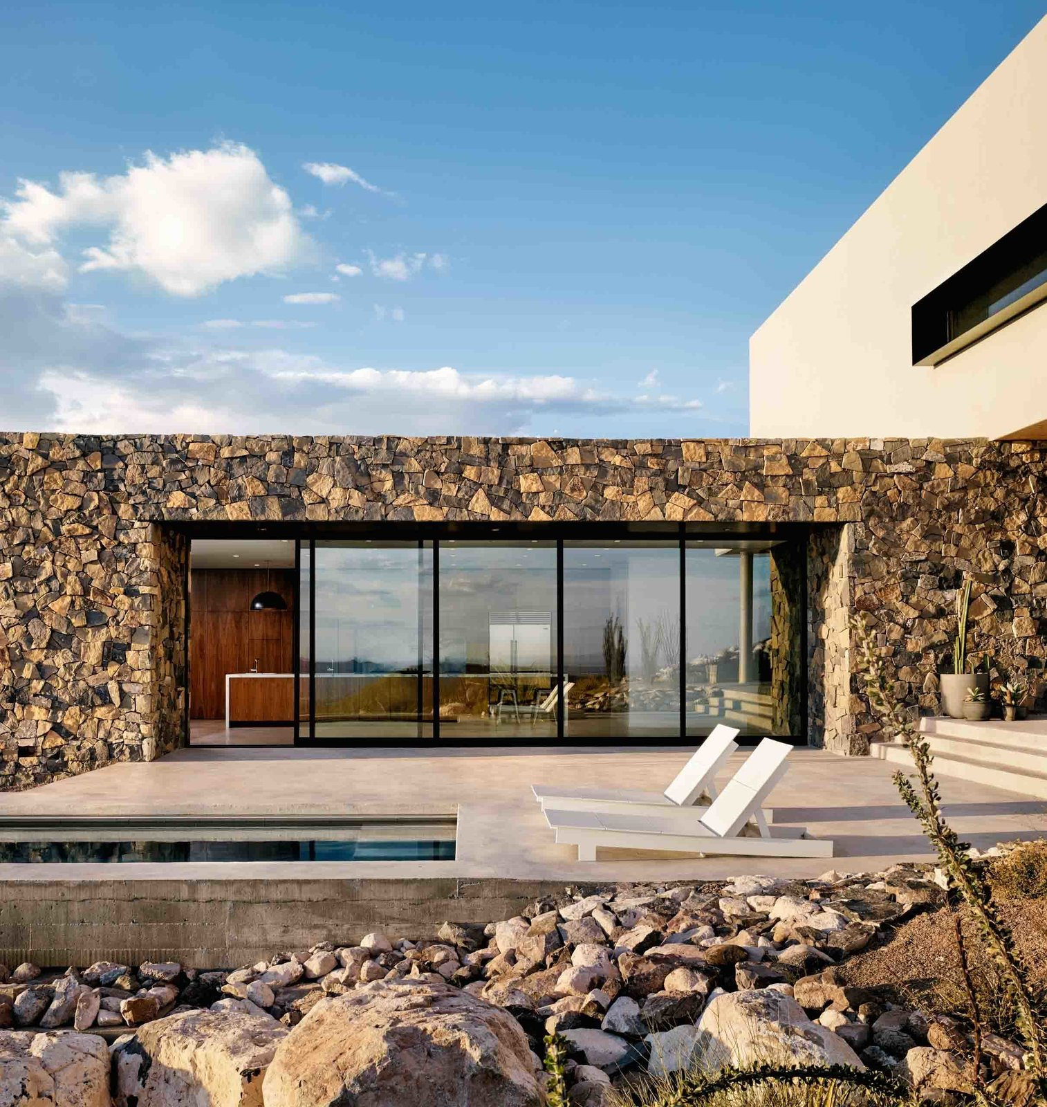 When the massive west-facing multi-slide door is open, cool Texas breezes course through the home's main volume.  West Texas Vistas by Western Window Systems