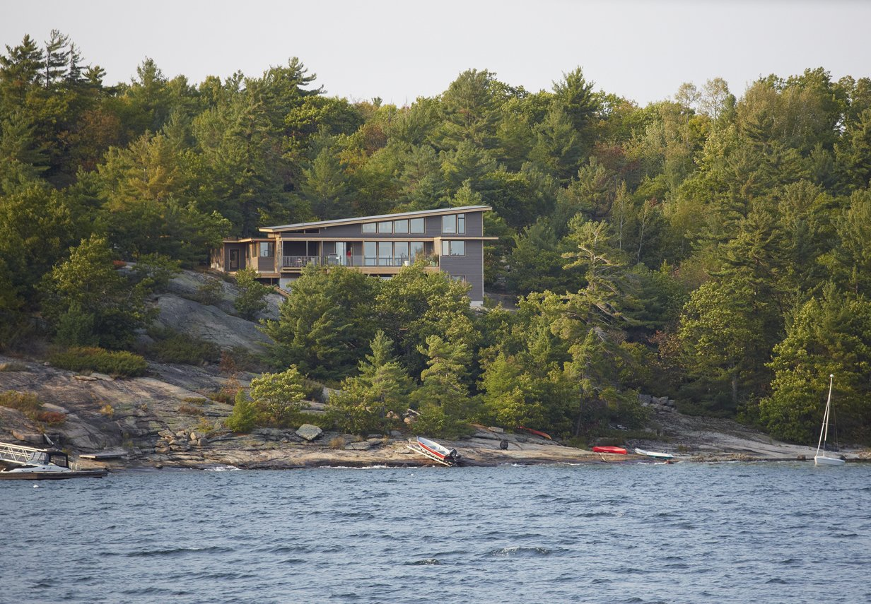 Tagged: Exterior, House, and Prefab Building Type.  Photo 3 of 6 in Turkel Design's Georgian Bay House Energy Conscious in the Canadian Shield