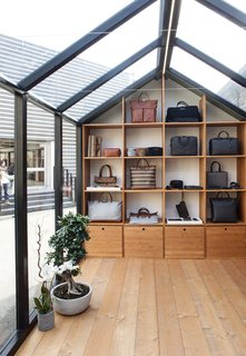 The Alpine Lodge by WANT Les Essentiels de la Vie - Photo 6 of 7 - The structure features custom millwork to display the brand's bags and accessories.