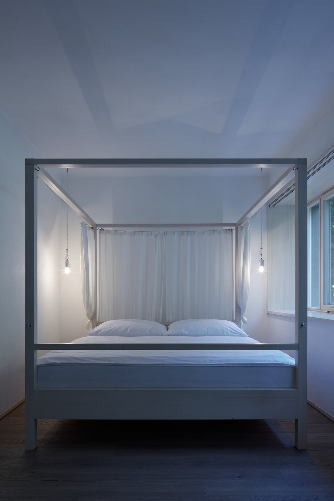 Tagged: Bedroom, Bed, Pendant Lighting, and Medium Hardwood Floor.  House by the Forrest by BoysPlayNice Photography & Concept