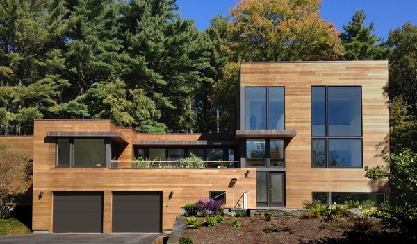 While the homeowners initially hoped to renovate and add on to their original home, a review of multiple renovation strategies revealed that it would be less expensive and less time-consuming to start from scratch and use a custom-designed prefab. Photo 9 of Custom Prefab House modern home