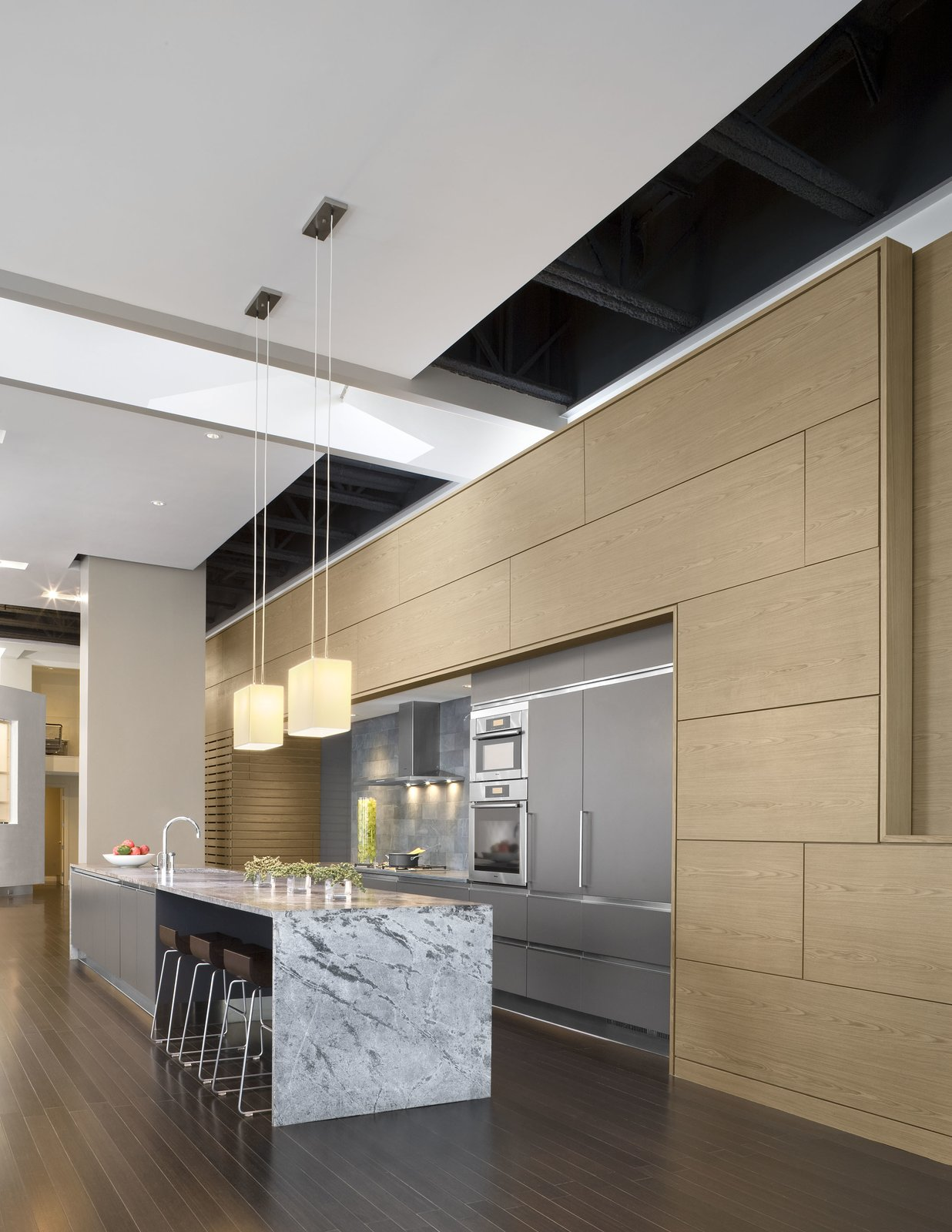 This Boston loft – nearly 5,000 SF with 18-foot high ceilings – presented a number of amazing opportunities and more than a few challenges. Chief among the opportunities was amplifying the immensity of the central living space – perhaps the largest in the city – while making an understandable and livable family house.  Urban Living XXL by Ruhl Walker Architects