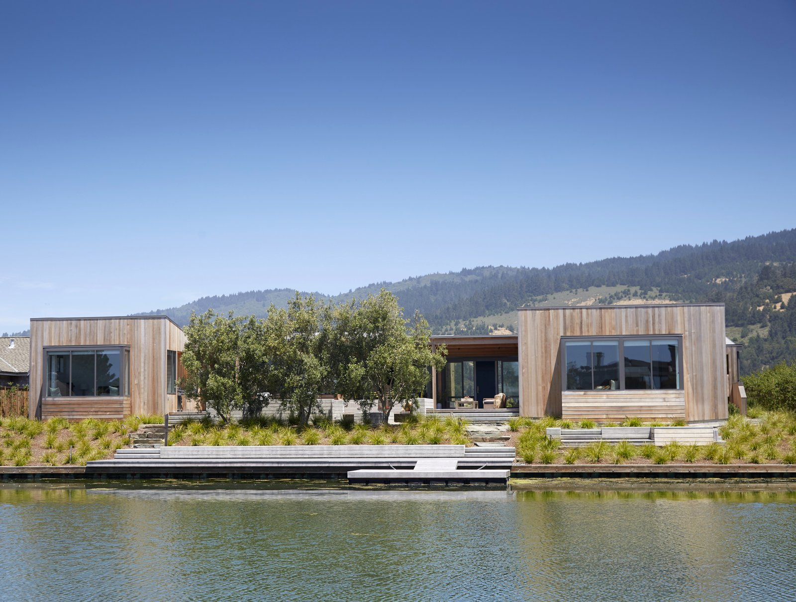 #TurnbullGriffinHaesloop #outdoor #exterior #landscape #lagoon #dock  Stinson Beach Lagoon Residence by Turnbull Griffin Haesloop Architects